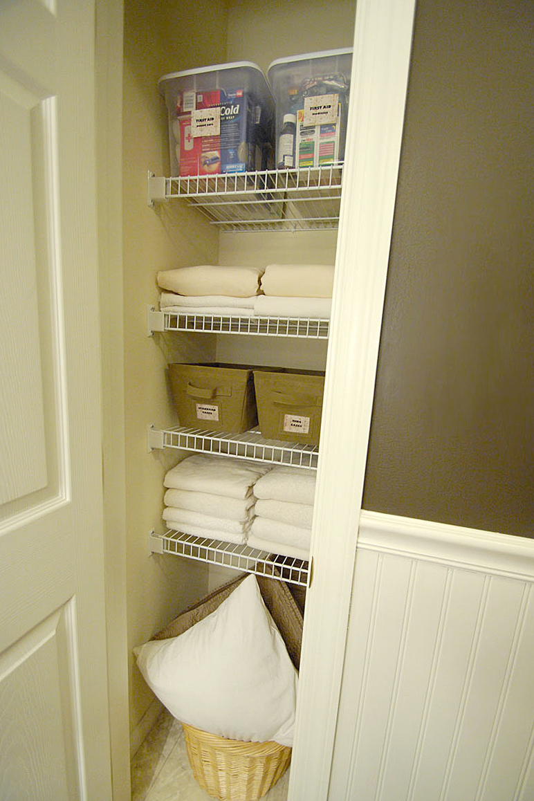 organizing the bathroom linen closet in our upstairs guest bathroom