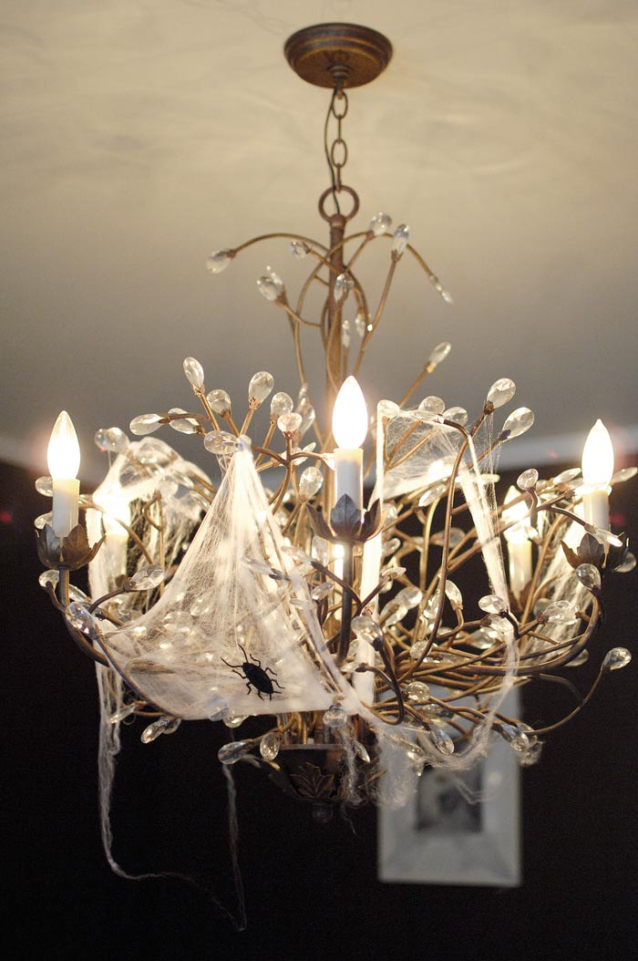 chandelier with cobwebs
